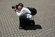 senior man taking photographs Japan