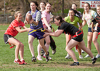 Senior Jenna Marchione tries to make her way through underclassmen Hannah Cimon and Victoria Holmes during the Powder Puff football game Friday afternoon at Laconia High School.   (Karen Bobotas/for the Laconia Daily Sun)
