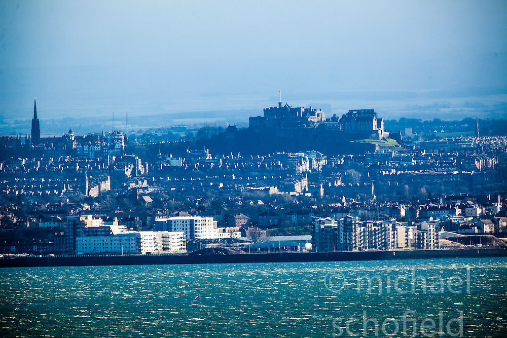 Edinburgh Castle and the River Forth coastline, as seen from the A921 near Burntisland, Fife.
