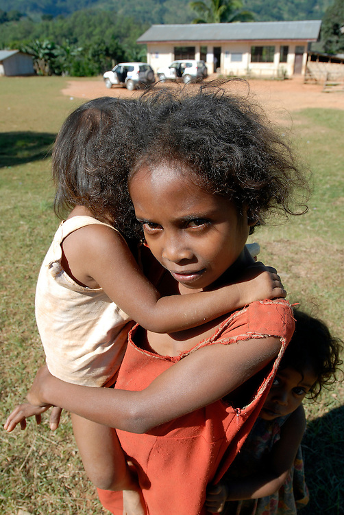 Germanio looks after her two shy siblings as the UN delivers Ballot Boxes to the polling station in Taraco, Timor-Leste.