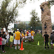 March 1, 2014, Palm Springs, California: <br /> Fans gather around a rock climbing wall during Kids Day at the Indian Wells Tennis Garden sponsored by the Coachella Valley National Junior Tennis and Learning Network.<br /> (Photo by Billie Weiss/BNP Paribas Open)