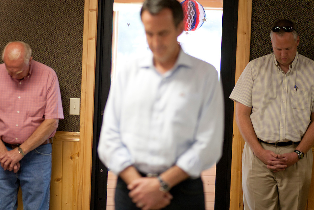 Republican presidential hopeful Tim Pawlenty, center, prays at the start of a campaign stop on Tuesday, August 9, 2011 in Humboldt, IA.