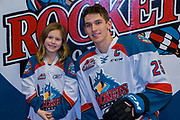 KELOWNA, CANADA - FEBRUARY 24:  Home Hardware Stick Girl with Cal Foote #25 of the Kelowna Rockets at the Kelowna Rockets game on February 24, 2018 at Prospera Place in Kelowna, British Columbia, Canada.  (Photo By Cindy Rogers/Nyasa Photography,  *** Local Caption ***