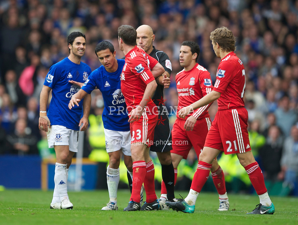LIVERPOOL, ENGLAND - Sunday, October 17, 2010: Liverpool's Jamie Carragher clashes with Everton's Mikel Arteta and Tim Cahill tries to diffuse the situation during the 214th Merseyside Derby match at Goodison Park. (Photo by David Rawcliffe/Propaganda)