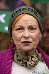 © London News Pictures. 05/10/2013.  London, UK. Fashion designer Vivienne Westwood (centre) attends the demo.  Supporters of Greenpeace stage a demonstration outside the Russian Embassy in London to protest against the arrest of 30 Greenpeace activists, known as the 'Arctic 30' who charged with piracy by a Russian court, following a peaceful protest against Arctic oil drilling at an oil platform in the Pechora Sea. Photo credit Ben Cawthra/LNP