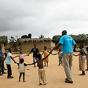 UNICEF Nutrition Specialist, Dr Faustin N'Dri, playing with children in the village of Yapleu in western Cote d'Ivoire.