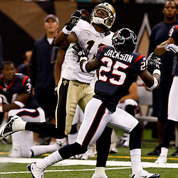 August 21, 2010; New Orleans, LA, USA; New Orleans Saints wide receiver Marques Colston (12) looks for a pass as Houston Texans defensive back Kareem Jackson (25) defends during a 38-20 win by the New Orleans Saints over the Houston Texans during a preseason game at the Louisiana Superdome. Mandatory Credit: Derick E. Hingle