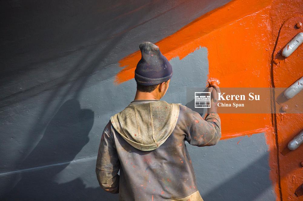Man painting boat, Essaouira, Morocco