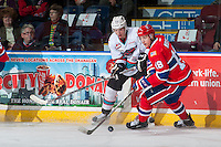 KELOWNA, CANADA - FEBRUARY 5: Jordan Borstmayer #11 of Kelowna Rockets checks Curtis Miske #18 of Spokane Chiefs on February 5, 2016 at Prospera Place in Kelowna, British Columbia, Canada.  (Photo by Marissa Baecker/Shoot the Breeze)  *** Local Caption *** Jordan Borstmayer; Curtis Miske;