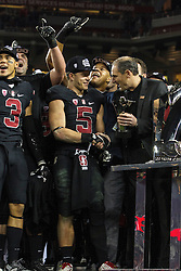 SANTA CLARA, CA - DECEMBER 05:  Running back Christian McCaffrey #5 of the Stanford Cardinal is presented with the MVP trophy by Larry Scott after the Pac-12 Championship game against the USC Trojans at Levi's Stadium on December 5, 2015 in Santa Clara, California. The Stanford Cardinal defeated the USC Trojans 41-22. (Photo by Jason O. Watson/Getty Images) *** Local Caption *** Christian McCaffrey; Larry Scott