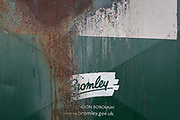 A detail of a rusting recycling bin showing the logo for Bromley Borough Council, on 3rd February 2020, in St. Mary Cray, London, England. Bromley's population in the 2011 census was 309,392. All major religions are represented, but of those stating a choice, 60.07% described themselves as Christian. Its 2019/20 Portfolio Budget (Education, Health, Environment & Community,  Recreation & Housing, Public Protection & Enforcement etc.) totalled £200m.