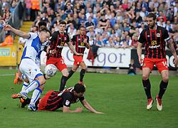 Ollie Clarke of Bristol Rovers is challenged by Corry Evans of Blackburn Rovers - Mandatory by-line: Neil Brookman/JMP - 14/04/2018 - FOOTBALL - Memorial Stadium - Bristol, England - Bristol Rovers v Blackburn Rovers - Sky Bet League One