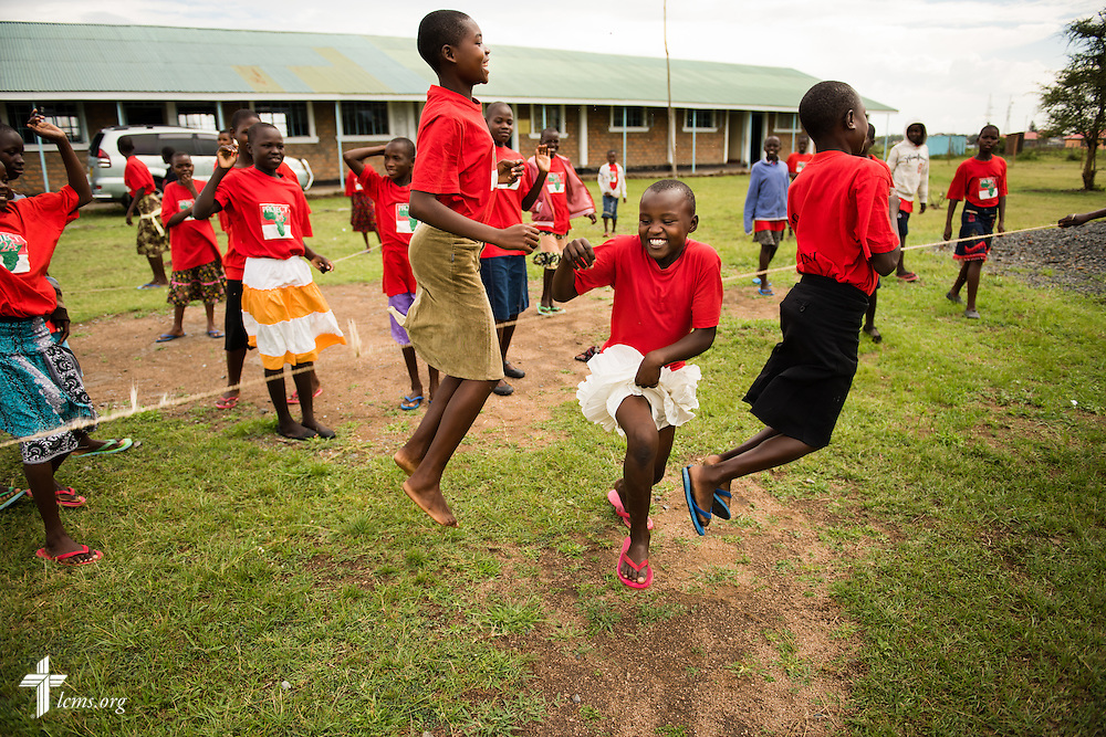 Young ladies jump rope during spare time at the Tumaini ELCK (Evangelical Lutheran Church in Kenya) Project 24 site on Sunday, Oct. 18, 2015, in Kisumu, Kenya. LCMS Communications/Erik M. Lunsford