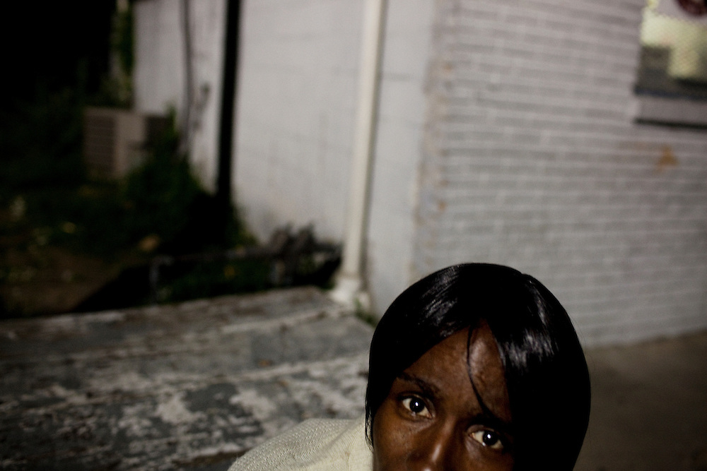 Vicki Wooten, 48, is raising three children alone while her husband, a four-time convicted felon, is serving time for running guns. Wooten sits outside of Hoover's Convenience Store and Laundry in Baptist Town, Mississippi on Wednesday, April 21, 2010.