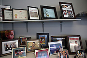 Picture frames filled with the accomplishments of D.C. Public Schools Chancellor Kaya Henderson  line her shelves in her office in Washington, D.C. Henderson recently announced that she plans to close 20 under-enrolled schools across the district. CREDIT: Lexey Swall for The Wall Street Journal