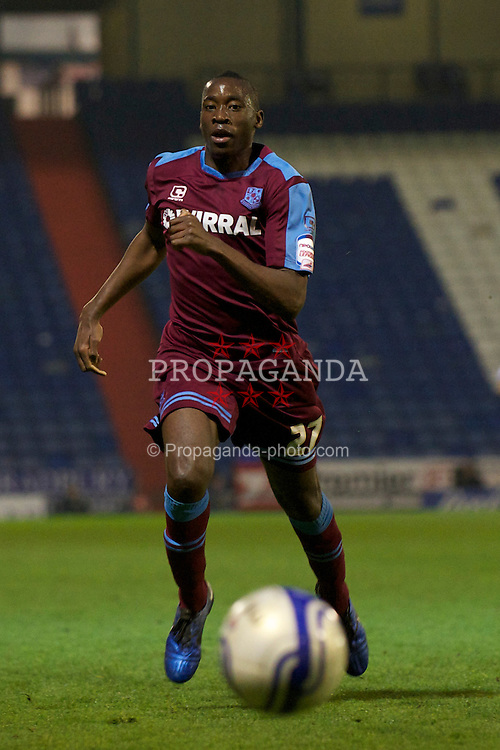 OLDHAM, ENGLAND - Monday, March 28, 2011: Tranmere Rovers' Lucas Akins in action against Oldham Athletic during the Football League One match at Boundary Park. (Photo by David Rawcliffe/Propaganda)