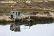 Baches along the Aparima River, Southland, New Zealand.  These baches are used as stations for catching white bait.