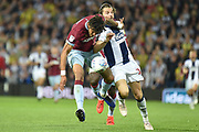Aston Villa defender (on loan from AFC Bournemouth) Tyrone Mings (40) battles for possession  with West Bromwich Albion striker Jay Rodriguez (19) during the EFL Sky Bet Championship play-off second leg match between West Bromwich Albion and Aston Villa at The Hawthorns, West Bromwich, England on 14 May 2019.