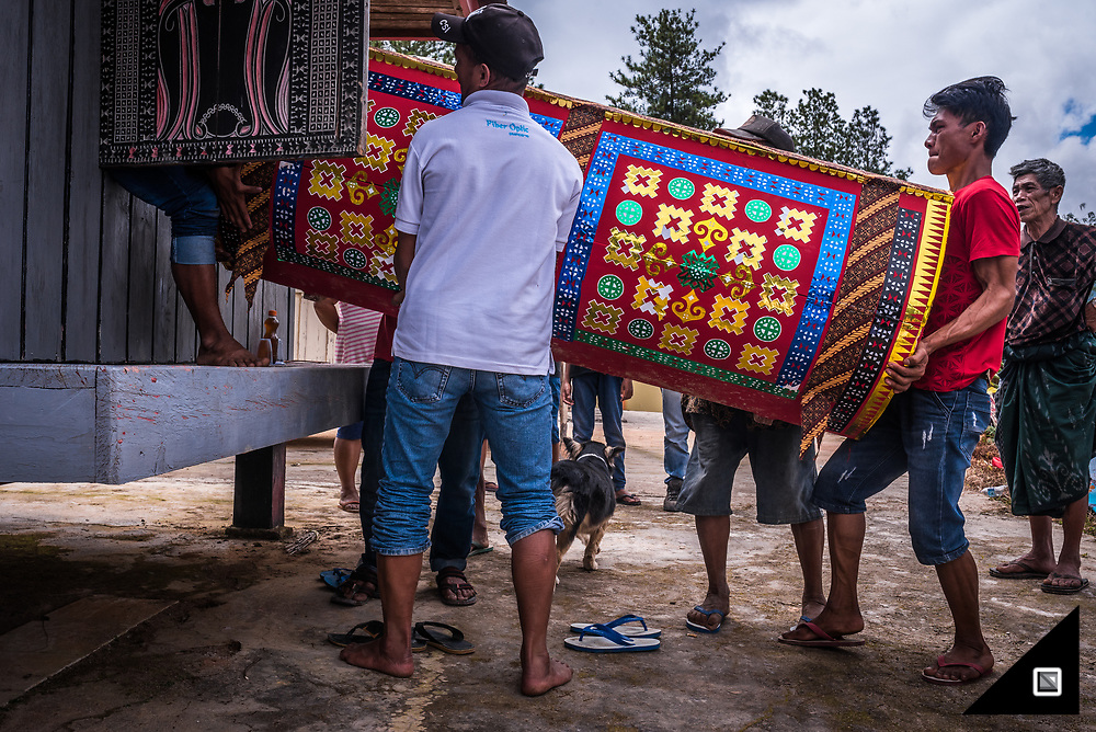 Indonesia - Sulawesi - Tana Toraja. Graveyard (Panggala, Rindigallo). The Ma'Nene Ritual is about to start as the coffins are dragged out of the family mausoleum