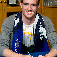 St Johnstone FC new signing David Robertson pictured putting pen to paper on his contract in the boardroom at McDiarmid Park.....<br /> see story by Gordon Bannerman Tel: 07729 865788<br /> Picture by Graeme Hart.<br /> Copyright Perthshire Picture Agency<br /> Tel: 01738 623350  Mobile: 07990 594431