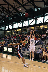 10 January 2009: Claire Sheehan shoots the long three. The Lady Titans of Illinois Wesleyan University downed the and Lady Thunder of Wheaton College by a score of 101 - 57 in the Shirk Center on the Illinois Wesleyan Campus in Bloomington Illinois.