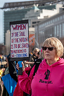 "San Francisco, USA. 19th January, 2019. The Women's March San Francisco begins with a rally at Civic Center Plaza in front of City Hall. During the rally, a woman wearing a pink ""Resist"" sweatshirt holds a sign with a quote from Coretta Scott King: ""Women, if the sould of the nation is to be saved, [I believe that] you must become its soul."" Credit: Shelly Rivoli/Alamy Live News"