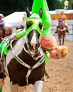 Trick rider,Kim Medicics, performs a headstand during the 2009 Cheyenne Frontier Days. Frontier Days has been exciting visitors from around the world for 113 years.
