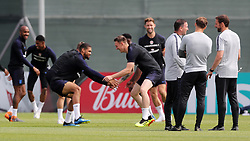 England's Ruben Loftus-Cheek (left) and Phil Jones (centre) are watched by England manager Gareth Southgate (right) during the training session at the Spartak Zelenogorsk Stadium, Zelenogorsk.
