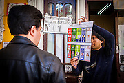 A member of the voting table shows the ballot to secure that it is clean and without any special reference to a candidate. On Sunday, 12th October, President Evo Morales was re-elected for a third term by a majority of 60% and will turn into the longest serving President of the country if he finishes is mandate in 2020.