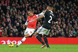 Arsenal's Theo Walcott and Southampton's Nathaniel Clyne compete for the ball - Photo mandatory by-line: Mitchell Gunn/JMP - Tel: Mobile: 07966 386802 23/11/2013 - SPORT - Football - London - Emirates Stadium - Arsenal v Southampton - Barclays Premier League