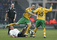 Preston - Saturday February 14th, 2009: Darren Carter of Preston North End fouls Lee Croft of Norwich City during the Coca Cola Championship match at Deepdale, Preston. (Pic by Michael Sedgwick/Focus Images)