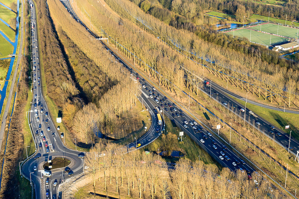 Nederland, Zuid-Holland, Reeuwijk, 18-02-2015. File op autosnelweg A12, ter hoogte van Reeuwijk.<br /> Traffic jam on the A12 motorway, near Reeuwijk.<br /> luchtfoto (toeslag op standard tarieven);<br /> aerial photo (additional fee required);<br /> copyright foto/photo Siebe Swart