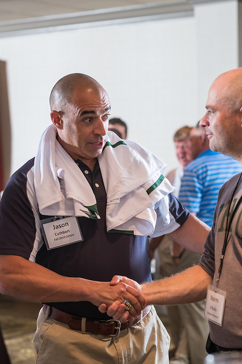 Jason Cuthbert, assistant activities director at the International School of Beijing, chats with Norm O'Reilly, faculty member in Sports Administratio, during the Master of Athletics Administration opening reception in the Ohio University Inn on Thursday, June 25, 2015.  Photo by Ohio University  /  Rob Hardin
