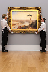 Sotheby's London, November 28th 2014.Sotheby's hold a preview for their December 3rd sale of Old Master and British Paintings at their Bond Street gallery. The exhibition runs from November 29th to December 3rd. PICTURED: Sotheby's gallery technicians hang  Turner's Rome, From Mount Aventine, the Star Lot in the auction with bids expected to be in the region of £15-20 million.