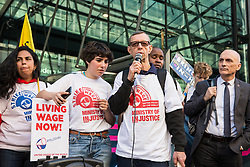 London, UK. 26th February, 2019. Carlos, a striking worker from the Ministry of Justice, addresses mainly migrant striking outsourced workers belonging to the Independent Workers of Great Britain (IWGB), United Voices of the World (UVW) and Public and Commercial Services Union (PCS) trade unions working at the University of London (IWGB), Ministry of Justice (UVW) and Department for Business Energy and Industrial Strategy (PCS), together with representatives of the National Union of Rail, Maritime and Transport Workers (RMT) Regional Council, taking part in a 'Clean Up Outsourcing' demonstration to call for an end to the practice of outsourcing. The demonstration was organised to coincide with a significant High Court hearing of an application by the IWGB for judicial review of a decision by the Central Arbitration Committee (CAC) not to hear their application for trade union recognition for the purposes of collective bargaining with the University of London.