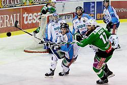 Derek Ryan (SAPA Fehervar AV19, #9) and Petr Sachl (HDD Tilia Olimpija, #12) during ice-hockey match between HDD Tilia Olimpija and SAPA Fehervar AV19 at second match in Quarterfinal  of EBEL league, on Februar 21, 2012 at Hala Tivoli, Ljubljana, Slovenia. HDD Tilia Olimpija won 2:1 in OT. (Photo By Matic Klansek Velej / Sportida)