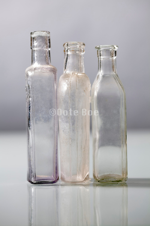 three old clear glass bottles