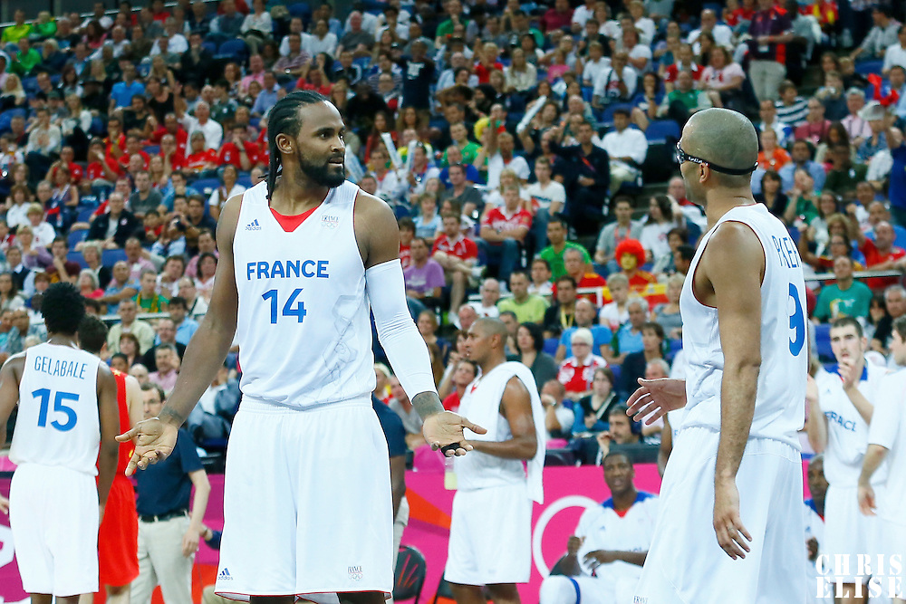 08 August 2012: France Ronny Turiaf listens to Tony Parker during 66-59 Team Spain victory over Team France, during the men's basketball quarter-finals, at the 02 Arena, in London, Great Britain.