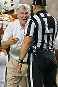 AUSTIN, TX - SEPTEMBER 14: Head coach Mack Brown of the Texas Longhorns has words with an official against the Mississippi Rebels before kickoff on September 14, 2013 at Darrell K Royal-Texas Memorial Stadium in Austin, Texas.  (Photo by Cooper Neill/Getty Images) *** Local Caption *** Mack Brown