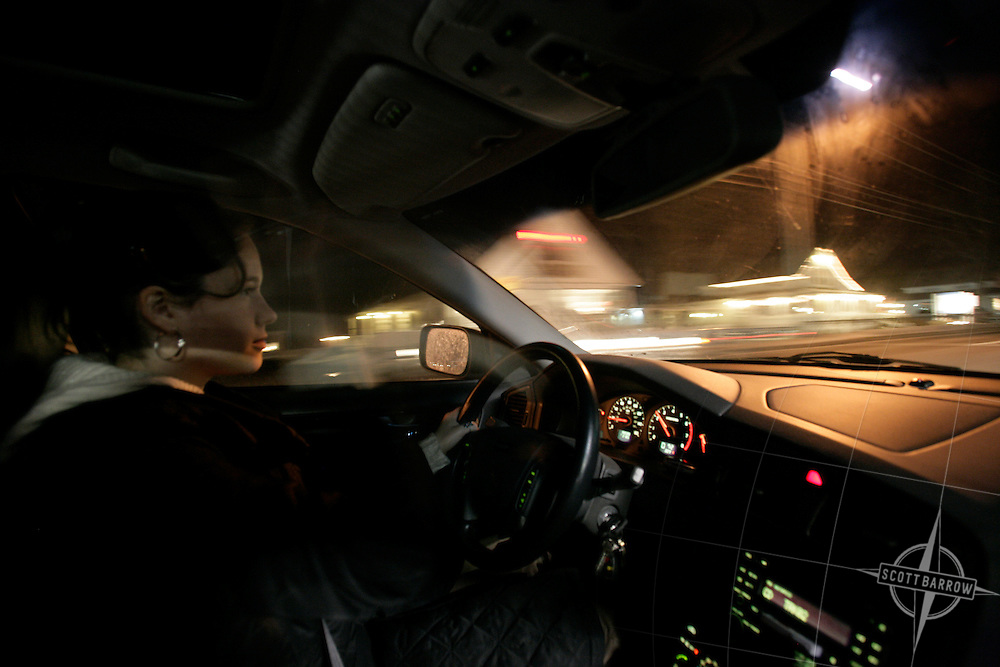 Young girl driving at night.