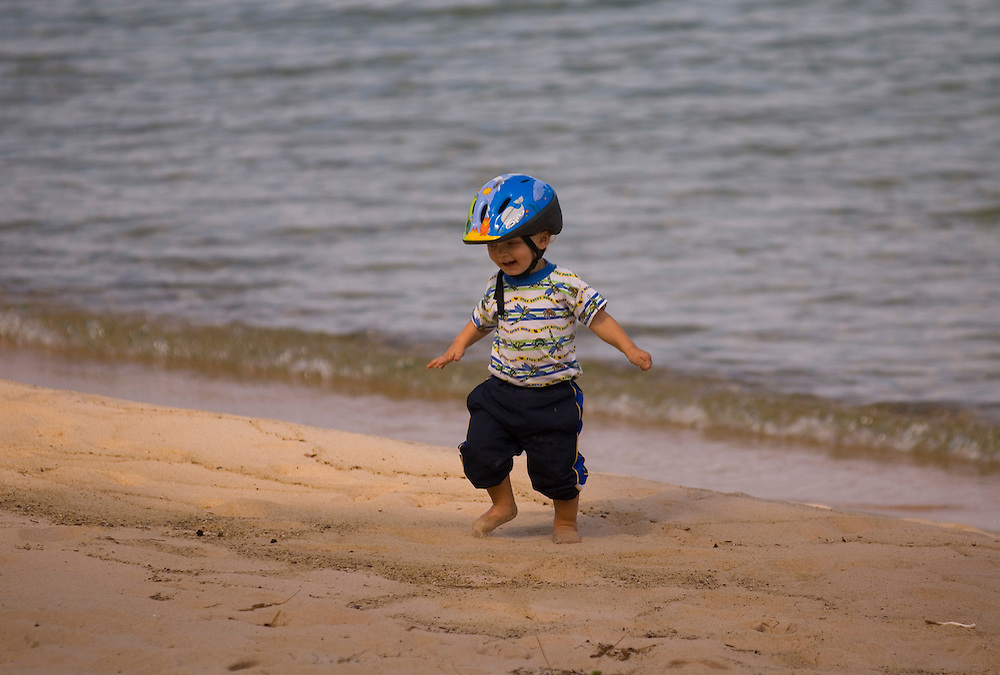 A young mountain biker explores the North Light beach on Grand Island National Recreation Area in Munising Michigan.