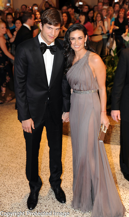 Ashton Kutcher and Demi Moore arrive for the White House Correspondents Dinner in Washington, DC