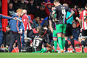 Bristol City defender, Scott Golbourne (13) receiving treatment and going off injured during the Sky Bet Championship match between Brentford and Bristol City at Griffin Park, London, England on 16 April 2016. Photo by Matthew Redman.