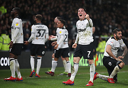 Derby County's Harry Wilson celebrates with fans after Derby County's Scott Malone hd scored the winning goal against Wigan Athletic,
