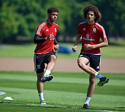 CARDIFF, WALES - Friday, June 3, 2016: Wales' Tyler Roberts and Ethan Ampadu during a training session at the Vale Resort Hotel ahead of the International Friendly match against Sweden. (Pic by David Rawcliffe/Propaganda)