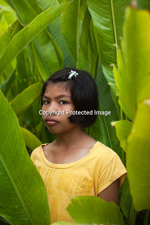 12 year old Tutu, is born with HIV..She lives together with other HIV Teenager and children in a village near Lopburi..