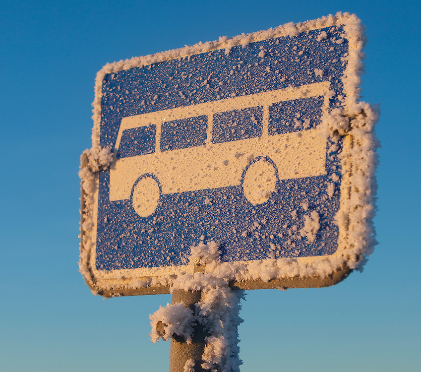 Norway Winter freezing cold snow january sun sunny Stange Norwegian winter.Bus sign bus stop Norwegian winterscape