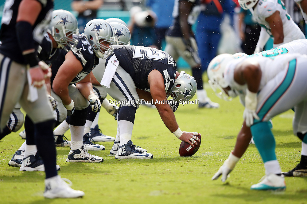 Dallas Cowboys center Travis Frederick (72) gets set to snap the ball as the Cowboys offensive line and the Miami Dolphins defensive line get set at the line of scrimmage during the 2015 week 11 regular season NFL football game against the Miami Dolphins on Sunday, Nov. 22, 2015 in Miami Gardens, Fla. The Cowboys won the game 24-14. (©Paul Anthony Spinelli)