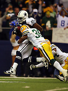IRVING, TX - NOVEMBER 29: Wide receiver Terrell Owens #81 of the Dallas Cowboys catches a pass and gets upended by safety Nick Collins #36 and cornerback Jarrett Bush #24 of the Green Bay Packers on November 29, 2007 at Texas Stadium in Irving, Texas. The Cowboys defeated the Packers 37-27. ©Paul Anthony Spinelli *** Local Caption *** Terrell Owens;Nick Collins;Jarrett Bush