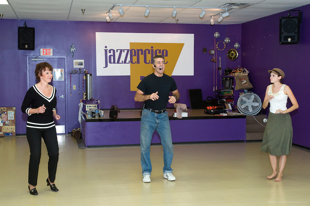 Tim Kelty leads a Salsa dance class at the Jazzercise studio in Mid-City Mall, Tuesday, Sept. 9, 2008 in Louisville Ky.  (Photo by Brian Bohannon/www.brianbohannon.com)